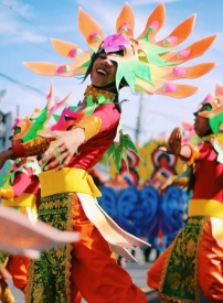shallow focus photography of person wearing multicolored costume
